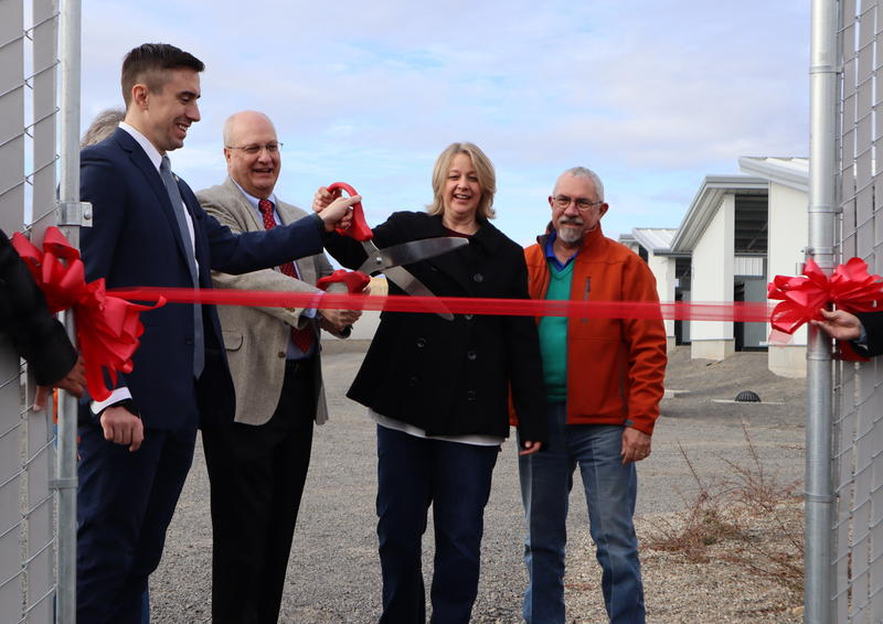Dignitaries cut the ribbon at the grand opening of Bitmain's new East Wenatchee bitcoin mine -- in other words, a data center that earns cryptocurrency.
