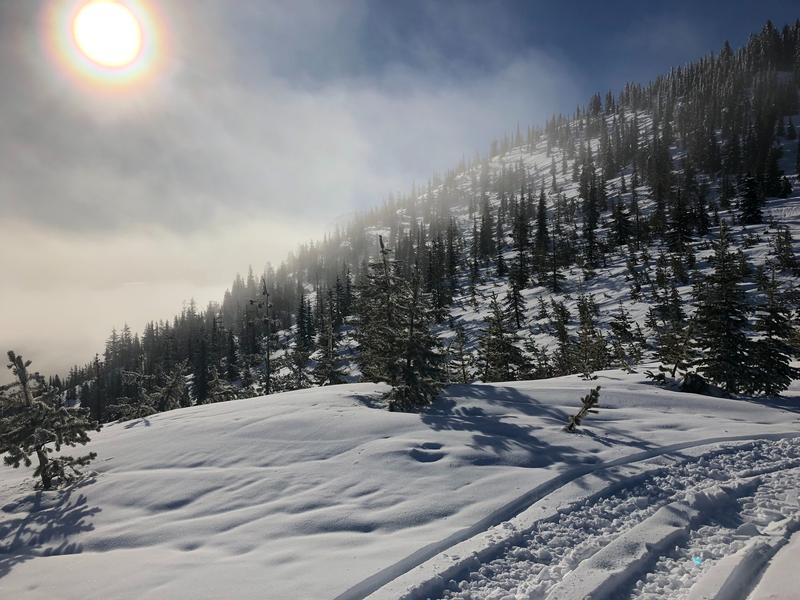 The Northwest's snowpack isn't as robust as water managers would like. At high-elevation near Mt. Adams, creases in the snowpack reveal where rain has run downhill.