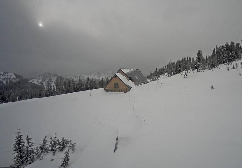 Deep snow surrounds the closed Jackson Visitor Center at Paradise in Mount Rainier National Park in this webcam view Sunday.