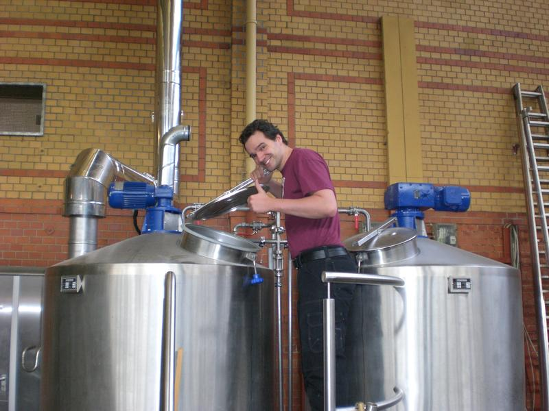 Michael Schwab standing over two tanks at Brewbaker, the brewery where he produces the distinctive Berliner Weisse.