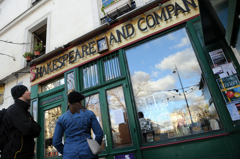 People look at the entrance of the bookshope 'Shakespeare and company' specialized in English-language literature on December 14, 2011 in Paris. George Whitman, the founder of this bookshop, a famed writers' refuge and English-language literary hub in the