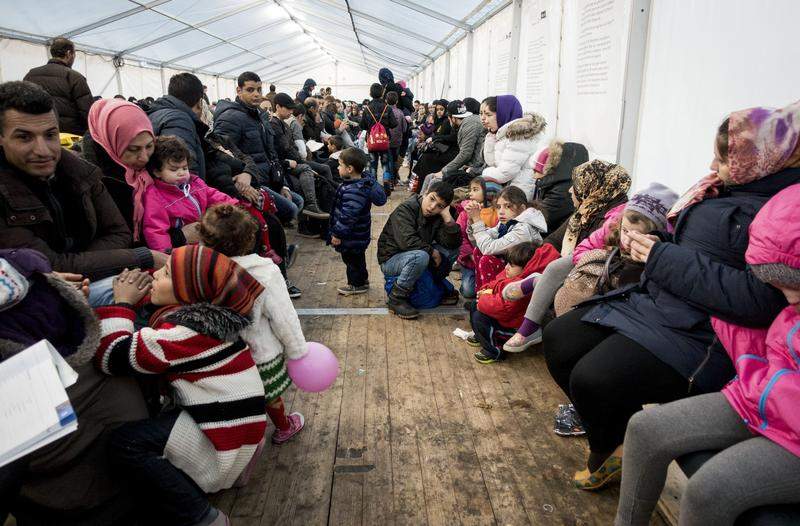 Refugees wait for their registration at the State Office of Health and Social Affairs in Berlin (LAGeSo) on November 9, 2015.