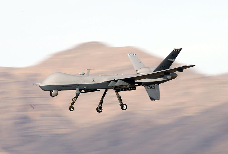 An MQ-9 Reaper remotely piloted aircraft (RPA) flies by during a training mission at Creech Air Force Base on November 17, 2015 in Indian Springs, Nevada.