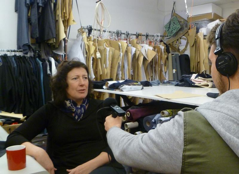 Photo of Melinda Stokes being interviewed at her clothing store, Stokx Shop.