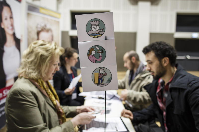 A symbol displays the category of a stand offering employment and job training possibilities at a job fair for refugees in Berlin, Germany. Germany is seeking a rapid integration of the thousands of newcomers it took in last year.