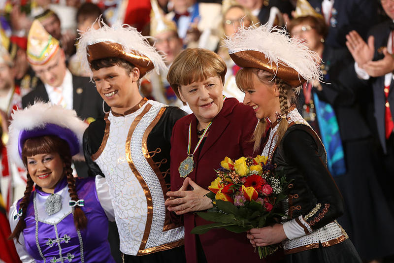 German Chancellor Angela Merkel poses with Carnival performers during the annual Carnival reception at the Chancellery on January 23, 2017 in Berlin, Germany. Carnival will soon begin across southwestern Germany.