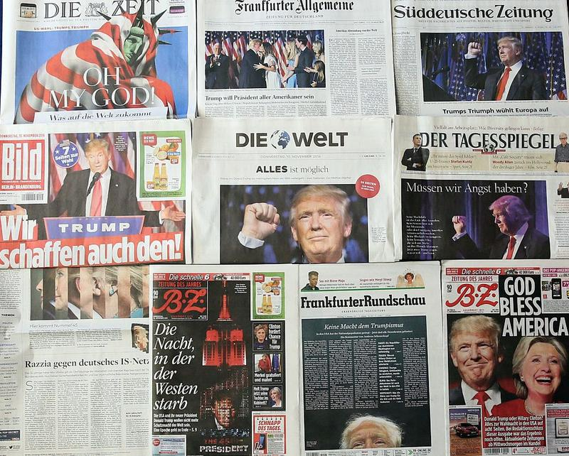 Photos and headlines related with US President-elecet Donald Trump's presidential win are seen in today's daily German newspapers in Berlin, Germany on November 10, 2016.