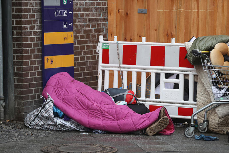 A homeless person lies covered by a sleeping bag on December 14, 2016 in Berlin, Germany. An estimated 3,000 to 6,000 homeless people live in Berlin.