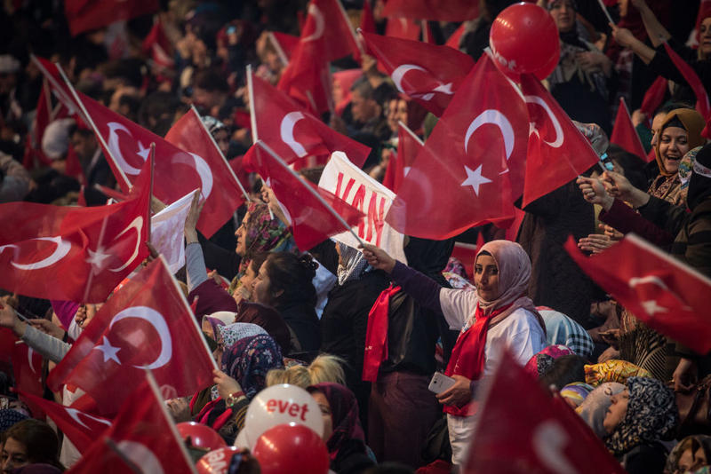 People wave national flags at a rally officially opening the AKP Party 'Yes' (Evet) constitutional referendum campaign held at the Ankara Arena on February 25, 2017 in Ankara, Turkey. Turkey will hold a constitutional referendum on April 16, 2017.