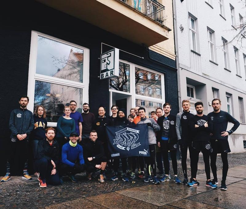 The Mikkeller Running Club Berlin poses with their banner. The club was founded by Mikkel Borg Bjergsø.