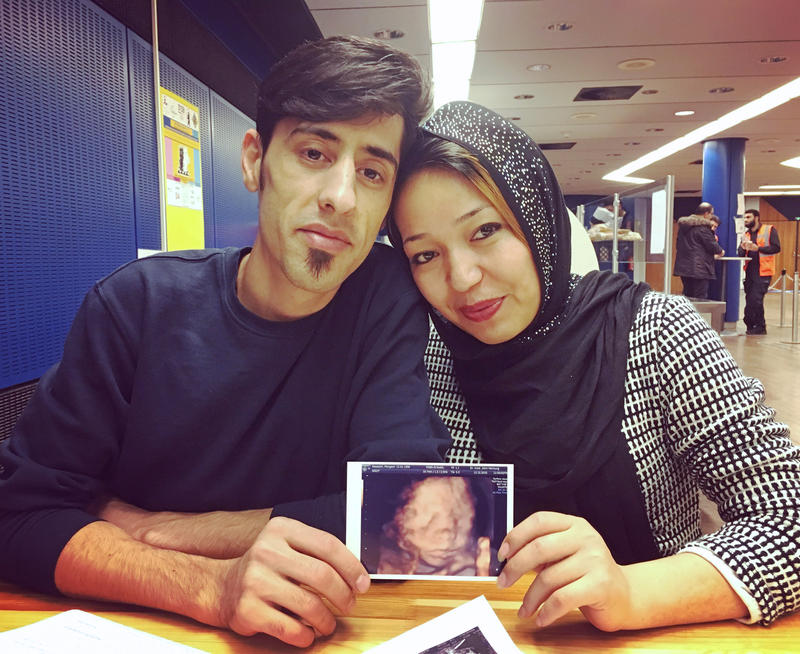 Javad and Maryam Hosseini hold an ultrasound picture of their daughter, Elena.