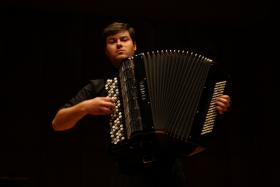 Spokane accordionist Yev Nosov, 24, is one of the U.S. musicians competing at the World Trophy Accordion Championship this year.