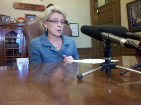Outgoing Washington Governor Chris Gregoire says campaign rhetoric doesn't match budget reality.