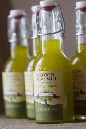 "The Durant family makes two different kinds of regional olive oil. One called a ""fresh press"" is their minimally processed oil which yields a greener, spicier flavor. The other, is high-quality extra virgin."