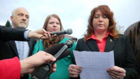 Robert Bales wife Karilyn, middle, listens as her sister reads a family statement to reporters at the conclusion of the pretrial hearing.