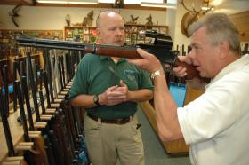 A customer looks over a gun. Gun sales expected to be high for Black Friday.