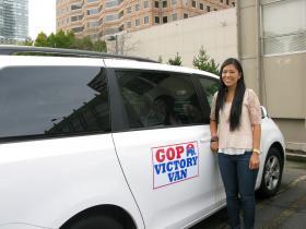 King County Executive Director Lisa Shin shows off a GOP Victory Van.