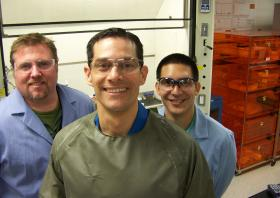 Carlos Fraga, center, is a Ph.D. chemist for the Pacific Northwest National Laboratory. Along with chemist Brian Dockendorff, left, and chemical engineer Gabriel Perez Acosta. He is trying to find ways to trace chemical agents back to their sources.