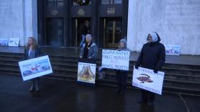 "People protesting the ""Nike bill"" gather outside the Oregon capitol building Friday morning."