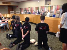 Students demonstrate CPR at a committee hearing.