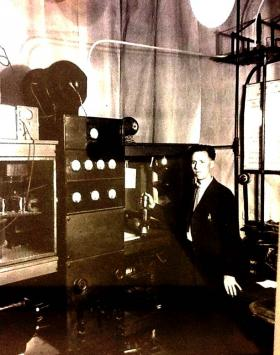 A KFAE engineer standing by the radio transmitter (circa 1925).
