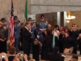 Democrat Jay Inslee takes the oath of office in a first-in-history ceremony in the capitol rotunda.