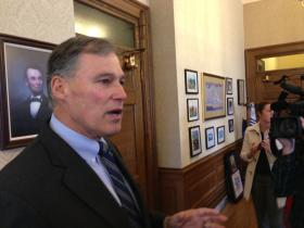 Washington Governor Jay Inslee gives reporters and cameras a tour of his office following a news conference.