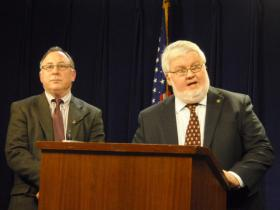 Ways & Means Co-chairs Representative Peter Buckley (left) and Senator Richard Devlin (right) outline their budget proposal at a state capitol press conference.