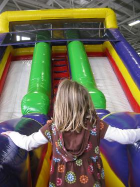 A child enjoys a bouncy house in Washington.