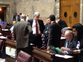 Hunter-Hill.jpg: Members of the Washington Senate's majority coalition huddle during a break in floor action on the final day of the regular session.