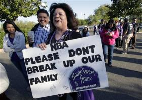 Sacramento Kings fan Gloria Bailey holds a sign campaigning to keep the team in Sacramento, Calif., as she stands in line before an NBA basketball game between the Kings and the Los Angeles Clippers, Wednesday, April 17.