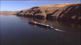 Barges take goods from Idaho's Port of Lewiston to the Pacific Ocean. Sediment is building up behind the lower Snake River's Lower Granite Dam, making travel more difficult.