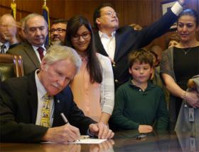 Oregon Gov. John Kitzhaber signs the state's 'tuition equity' bill.