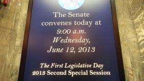 The electronic reader board in the Washington Senate announced the first day of the second special session.