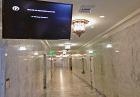 "As budget negotiations drag on, an empty hallway and a ""No Meetings Scheduled"" message board greet visitors to the House office building in Olympia."