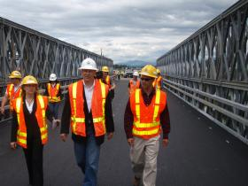 Wash. Sec. of Transportation Lynn Peterson (left) and WSDOT regional administrator Jim Drye (right) give a tour to Gov. Jay Inslee