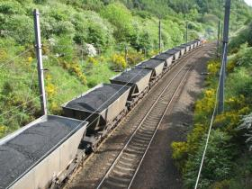 Environmental groups say that the rail and coal companies are violating the Clean Water Act by allowing coal to escape from trains that travel through the region.