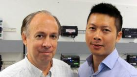 Michael Brambley (left) and Guopeng Liu in Pacific Northwest National Laboratory's Building Controls Lab. New research at the lab has found a way to keep you more comfortable and keep office costs down.
