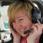 Jessie Jacobs in an airplane, clearly preparing for her role as your Friday afternoon classical music host.