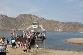 The M.V. Sanpoil makes its inaugural trip across the Columbia River at the Keller Ferry crossing. Crowds turned out for the christening, but usually there's little foot traffic on this remote ferry.