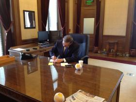 Governor Inslee in the Governors Office moments before delivering his inaugural address in January. Writing a letter to the head of a clean energy company the Governor hopes will relocate to Washington.