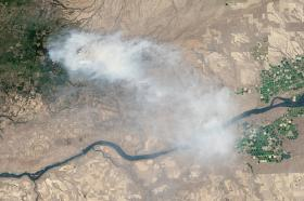 A NASA Earth observatory image of mile marker 28 in the Simcoe Mountains northeast of Goldendale, Washington where eight major wildfires have burned through forests and grasslands in the Pacific Northwest.