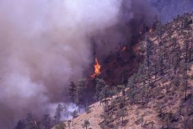 The Bureau of Land Management and the U.S. Forest Service work together to manage wildfires in Oregon