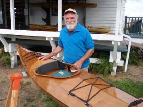 """Pygmy Boats owner John Lockwood with his newest creation, a model named """"The Freya"""" after his daughter."""