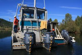 Technicians contracted by the EPA are gather core samples of the Coeur d'Alene River bed.