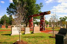 An example of these totem poles created by the Lummi Nation's  House of Tears Carvers was erected in the Congressional Cemetery of Washington D.C.