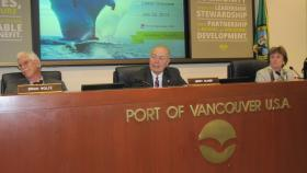 Jerry Oliver, center, is the president of the Port of Vancouver Commission
