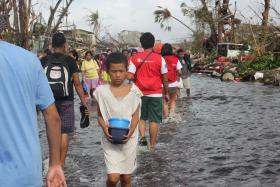 As disaster relief in the Philippines shifts from crisis to rebuilding, some volunteers from the Northwest are also shifting gears.