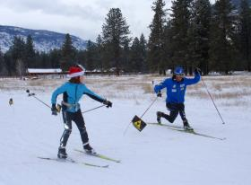 2014 U.S. Nordic Olympic team member Erik Bjornsen of Mazama, Wash. demonstrated a finishing lunge for a Methow Valley youngster in December.