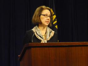 Oregon Attorney General Ellen Rosenblum takes questions from reporters during a state capitol press conference.